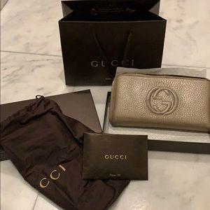 Gold Metallic Gucci double G zippy wallet